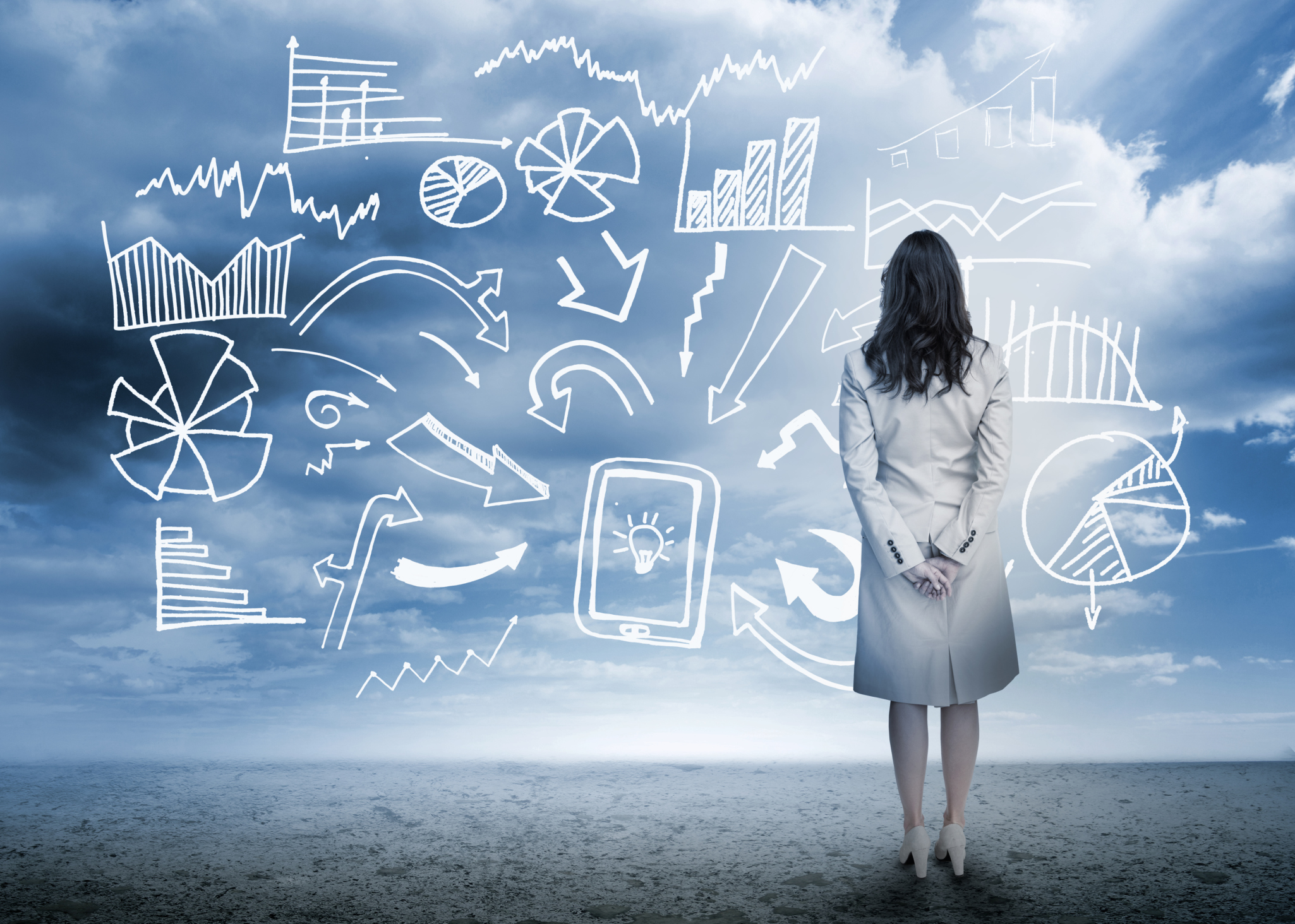 Businesswoman standing looking at data flowchart